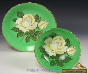 PARAGON HUGE WHITE ROSES GREEN TEA CUP AND SAUCER for Sale