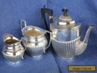 Antique hallmarked silver teapot plus an E.P. milk jug and sugar bowl.