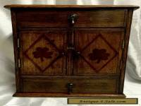 EARLY 20TH CENTURY  OAK TABLE CABINET - ENCLOSING A BRASS RACK