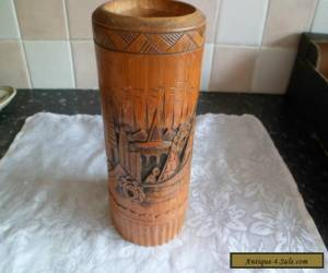 Carved wooden vase with a man & boat for Sale