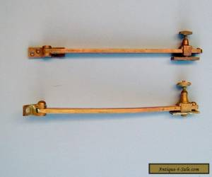 Vintage Pair of Brass Window Arms with Screw Locks for Sale