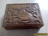 vintage wooden box with raised carved picture