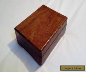 A vintage wooden box possibly an old musical box for Sale