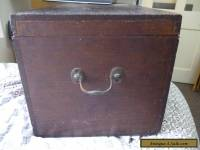 old wooden box with brass side handles