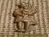 Quaint Scots piper old brass door knocker