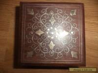 inlaid brass on  wooden box